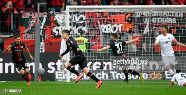 Leverkusen's German midfielder Kai Havertz celebrates with his teammates Leverkusen's Argentinean forward Lucas Alario and Leverkusen's German...