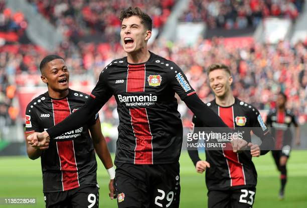 TOPSHOT Leverkusen's German midfielder Kai Havertz celebrates with Leverkusen's Jamaican midfielder Leon Bailey and Leverkusen's German defender...
