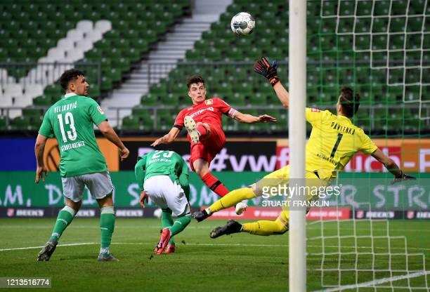 TOPSHOT Leverkusen's German midfielder Kai Havertz scores the opening goal during the German first division Bundesliga football match Werder Bremen v...