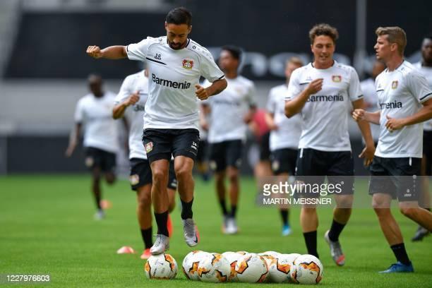 Leverkusen's German midfielder Karim Bellarabi takes part in a training session on the eve of the UEFA Europa League quarter-final football match...