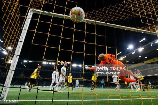Leverkusen's goalkeeper Niklas Lomb fails to stop a goal by Young Boys' French forward Jordan Siebatcheu during the UEFA Europa League round of 32...