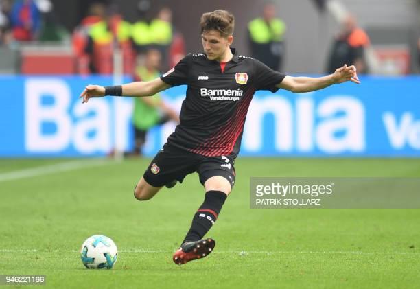 Leverkusen's Greek defender Panagiotis Retsos kicks the ball during the German first division Bundesliga football match Bayer 04 Leverkusen vs...