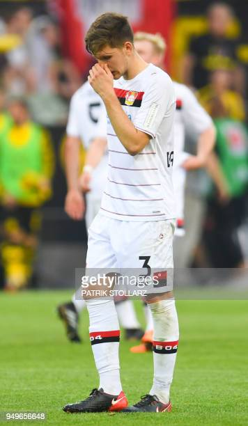 Leverkusen's Greek defender Panagiotis Retsos reacts after the German first division Bundesliga football match Borussia Dortmund vs Bayer Leverkusen...