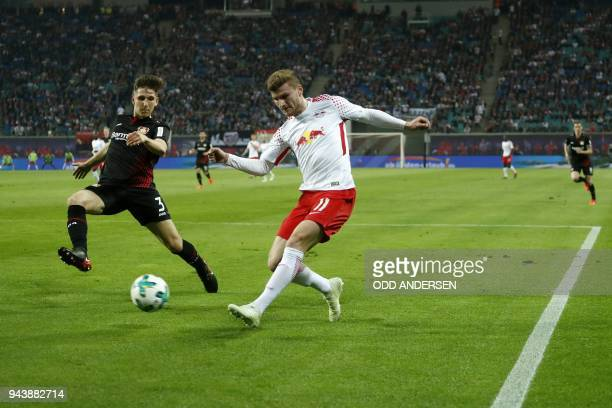 Leverkusen's Greek defender Panagiotis Retsos vies with Leipzig's German forward Timo Werner during the German first division Bundesliga football...