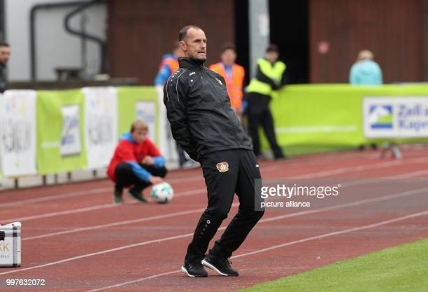 Leverkusen's head coach Heiko Herrlich is angry and leans back during the test match between Bayer Leverkusen and Antalyaspor in Zell am See Austria...