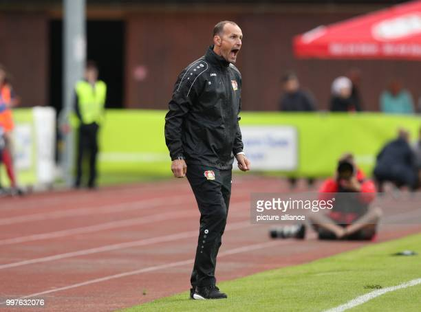 Leverkusen's head coach Heiko Herrlich shouts angrily in the direction of his players during the test match between Bayer Leverkusen and Antalyaspor...