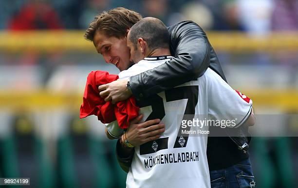 Leverkusen's injured goalkeeper Rene Adler comforts Oliver Neuville of Gladbach after the Bundesliga match between Borussia Moenchengladbach and...