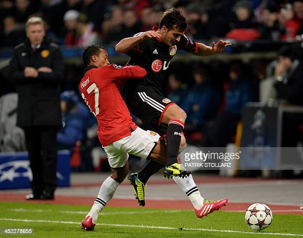 Leverkusen's Italian defender Giulio Donati and Manchester United's Portuguese midfielder Nani vie for the ball during the UEFA Champions League...