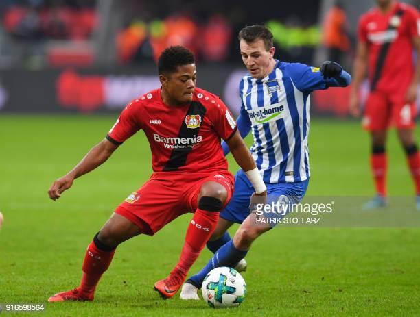 Leverkusen's Jamaican midfielder Leon Bailey and Berlin's Czech midfielder Vladimir Darida vie for the ball during the German first division...