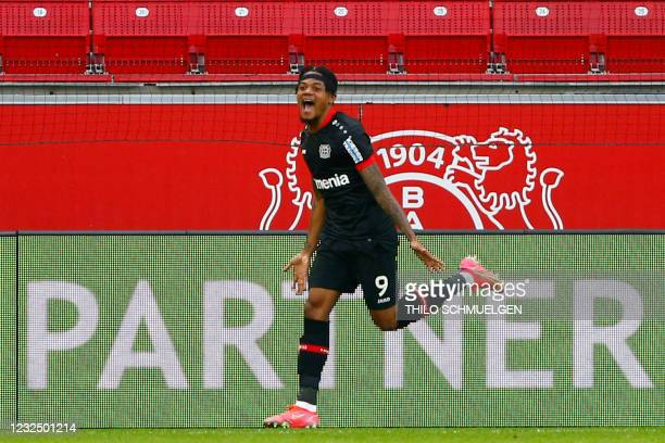 Leverkusen's Jamaican midfielder Leon Bailey celebrates scoring the opening goal during the German first division Bundesliga football match between...