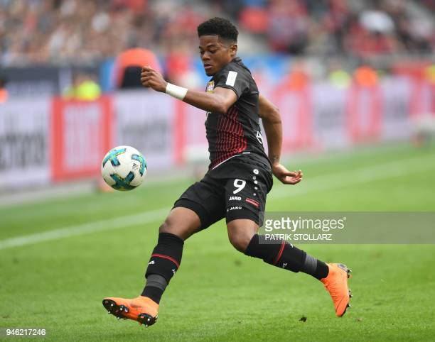 Leverkusen's Jamaican midfielder Leon Bailey controls the ball during the German first division Bundesliga football match Bayer 04 Leverkusen vs...