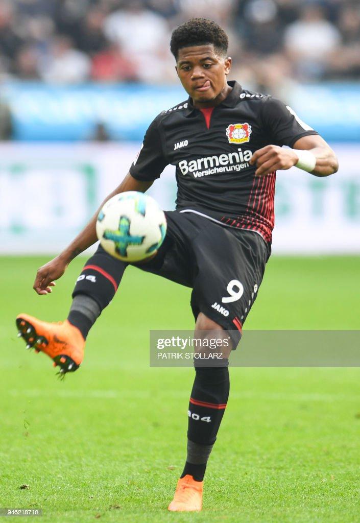Leverkusen's Jamaican midfielder Leon Bailey controls the ball during the German first division Bundesliga football match Bayer 04 Leverkusen vs Eintracht Frankfurt, in Leverkusen, western Germany, on April 14, 2018. / AFP PHOTO / Patrik