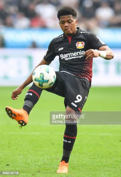 Leverkusen's Jamaican midfielder Leon Bailey controls the ball during the German first division Bundesliga football match Bayer 04 Leverkusen vs...