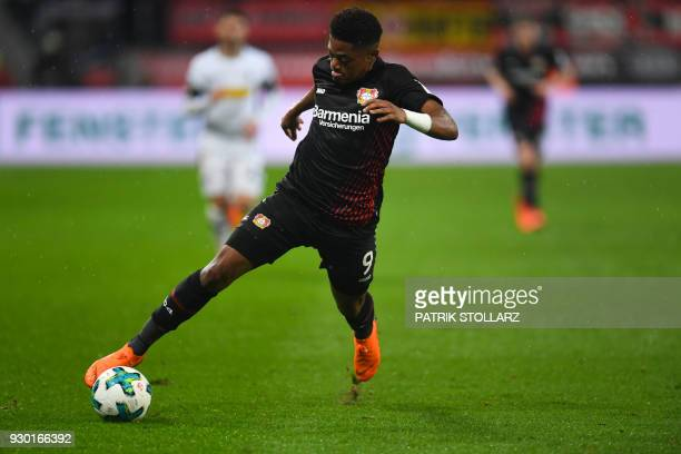Leverkusen's Jamaican midfielder Leon Bailey plays the ball during the German first division Bundesliga football match Bayer 04 Leverkusen vs...