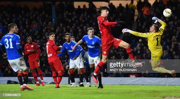 Leverkusen's Jamaican midfielder Leon Bailey scores his team's third goal during the UEFA Europa League round of 16 first leg football match between...