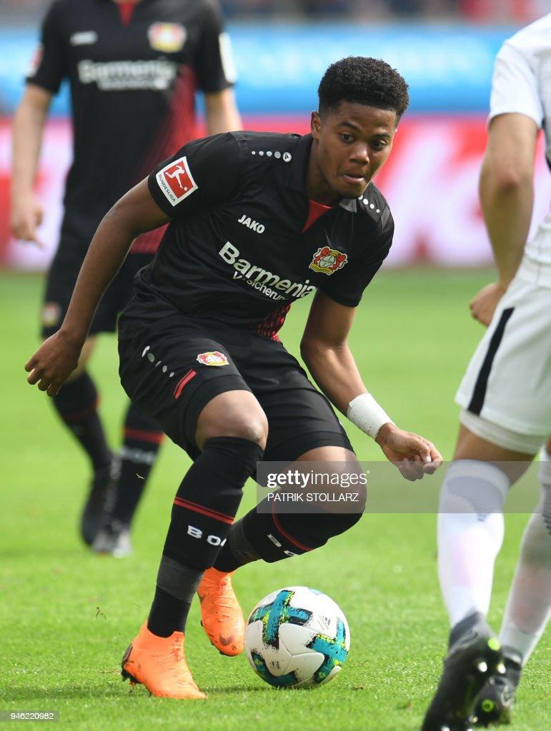 Leverkusen's Jamaican midfielder Leon Bailey vies for the ball during the German first division Bundesliga football match Bayer 04 Leverkusen vs Eintracht Frankfurt, in Leverkusen, western Germany, on April 14, 2018. / AFP PHOTO / Patrik