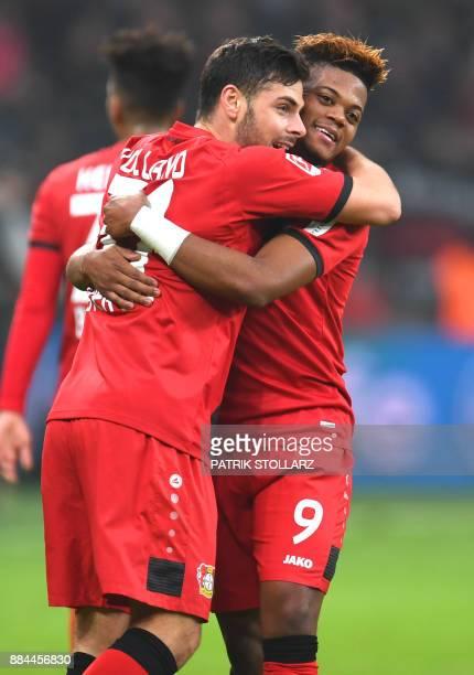 Leverkusen´s Jamaican striker Leon Bailey and Leverkusen´s striker Kevin Volland react duringng the German First division Bundesliga football match...