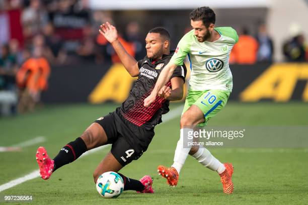 Leverkusen's Jonathan Tah and Wolfsburg's Yunus Malli vie for the ball during the German Bundesliga soccer match between Bayer Leverkusen and VfL...