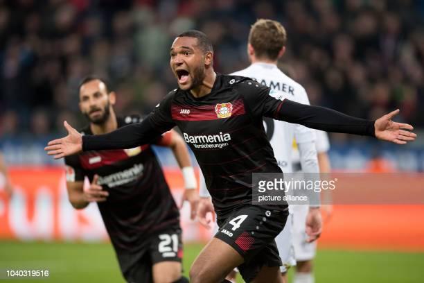 Leverkusen's Jonathan Tah cheers after his 1-0 score during the German Bundesliga soccer match between Bayer Leverkusen and Bor. Mönchengladbach at...