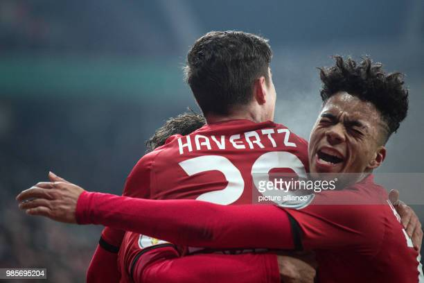 Leverkusen's Kai Havertz celebrating with Leon Bailey his scoring of the 42 during the German DFB Cup quarterfinal soccer match between Bayer...
