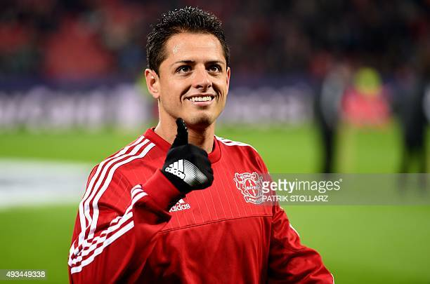 Leverkusen's Mexican forward Javier Hernandez gestures prior to the Group E firstleg UEFA Champions League football match Bayer Leverkusen vs AS Roma...