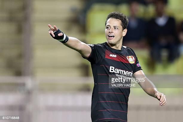 Leverkusen's Mexican forward Javier Hernández Balcázar celebrates after scoring a goal during the UEFA Champions League football match AS Monaco vs...