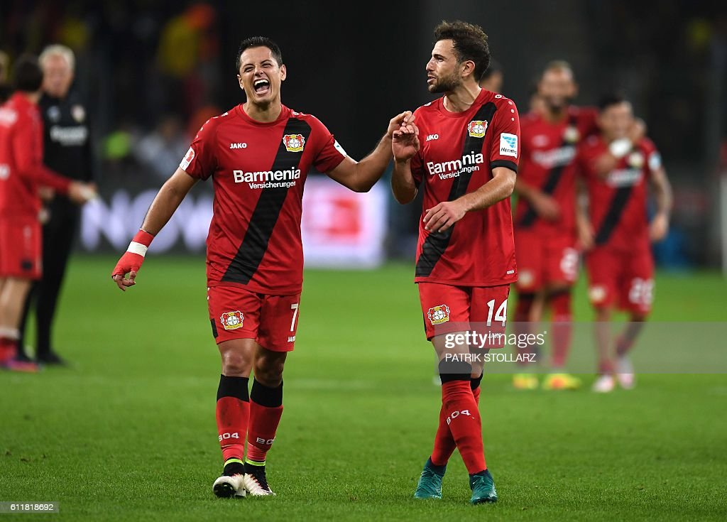 Leverkusen's Mexican striker Javier 'Chicharito' Hernandez (L) and Leverkusen's Swiss forward Admir Mehmedi celebrate after vie for the ball during the German first division Bundesliga football match between Bayer 04 Leverkusen and BVB Borussia Dortmund in the Bay Arena in Leverkusen, western Germany on October 1, 2016. / AFP / PATRIK