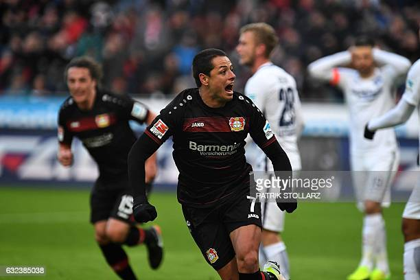 Leverkusen's Mexican striker Javier 'Chicharito' Hernandez celebrates during the German first division Bundesliga football match of Bayer Leverkusen...