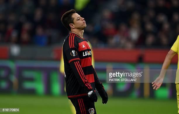 Leverkusen's Mexican striker Javier Hernandez reacts during the UEFA Europa League Round of 16 second leg football match Bayer Leverkusen vs...