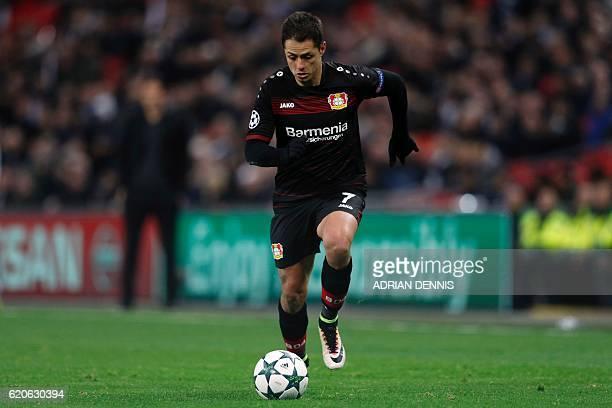 Leverkusen's Mexican striker Javier Hernandez runs with the ball during the UEFA Champions League group E football match between Tottenham Hotspur...