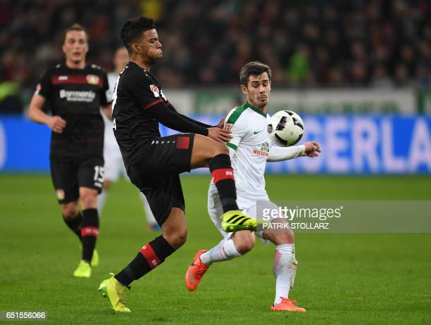 Leverkusen's midfielder Benjamin Henrichs and Bremen's midfielder Fin Bartels vie for the ball during the German First division Bundesliga football...