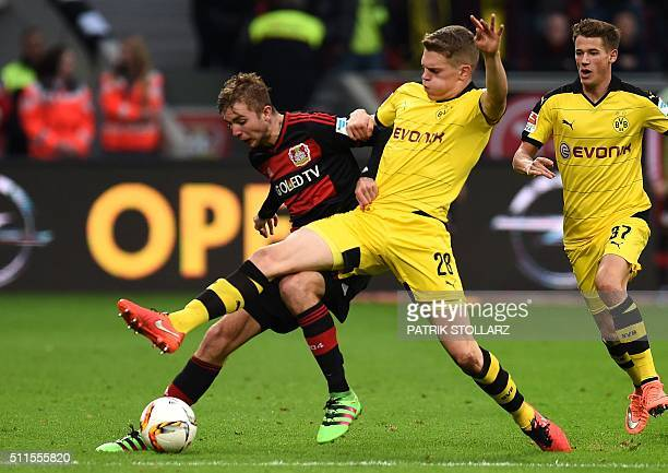 Leverkusen's midfielder Christoph Kramer and Dortmund's defender Matthias Ginter vie for the ball during the German first division Bundesliga...