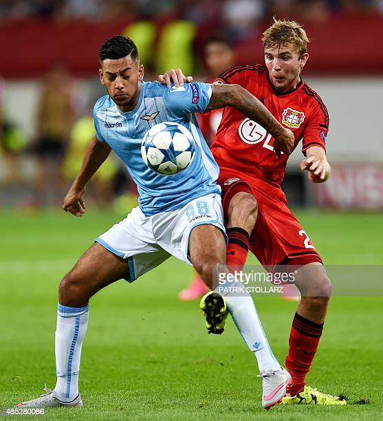 Leverkusen's midfielder Christoph Kramer and Lazio's forward from Netherlands Ricardo Kishna vie for the ball during the UEFA Champions League second...