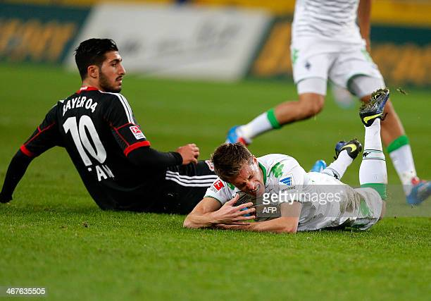 Leverkusen's midfielder Emre Can and Moenchengladbach's midfielder Patrick Herrmann vie for the ball during the German first division Bundesliga...