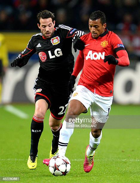 Leverkusen's midfielder Gonzalo Castro and Manchester´s Nani vie for the ball during the UEFA Champions League Group A football match Bayern...