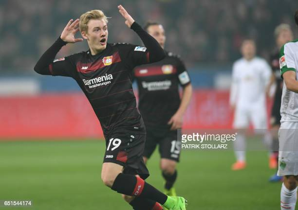 Leverkusen's midfielder Julian Brandt and his teammates celebrate during the German First division Bundesliga football match Bayer Leverkusen vs...