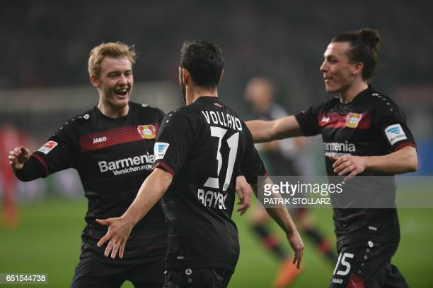 Leverkusen's midfielder Julian Brandt and Leverkusen's forward Kevin Volland celebrate during the German First division Bundesliga football match...