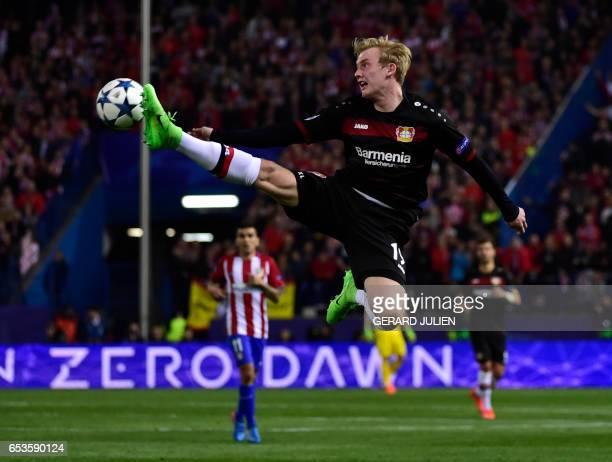 Leverkusen's midfielder Julian Brandt jumps for a ball during the UEFA Champions League round of 16 second leg football match Club Atletico de Madrid...