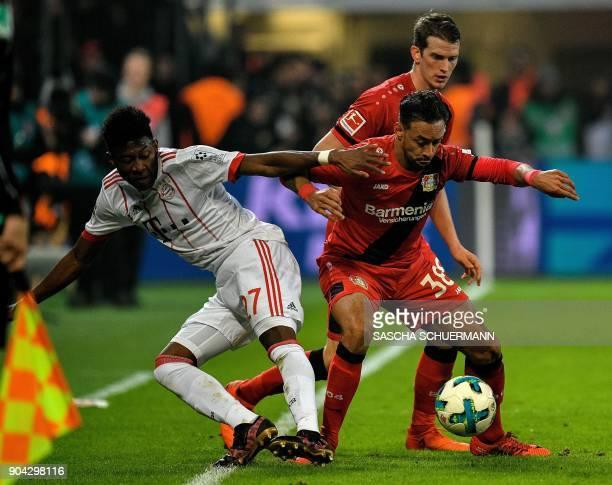 Leverkusen's midfielder Karim Bellarabi and Bayern Munich's Austrian defender David Alaba vie for the ball during the German First division...