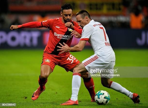Leverkusen's midfielder Karim Bellarabi and Bayern Munich's French midfielder Franck Ribery vie for the ball during the German First division...