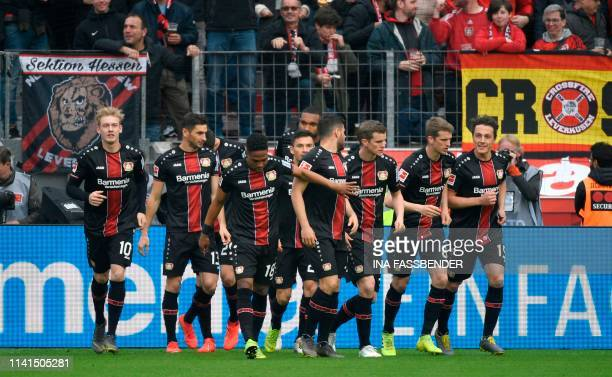 Leverkusen's players celebrate after scoring the 10 during the German first division Bundesliga football match Bayer Leverkusen vs Eintracht...