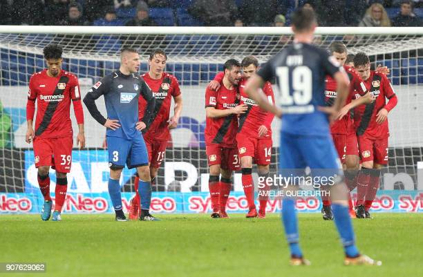 Leverkusen's players celebrate after scoring the 14 during the German First division Bundesliga football match TSG 1899 Hoffenheim vs Bayer 04...