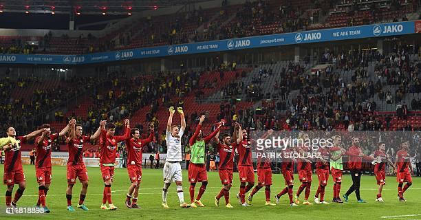 Leverkusen´s players celebrate after the German first division Bundesliga football match between Bayer 04 Leverkusen and BVB Borussia Dortmund in the...