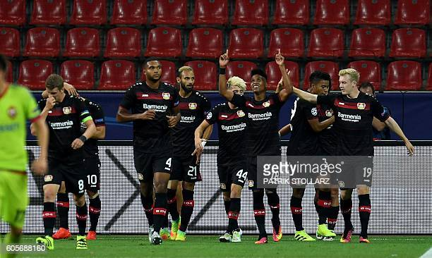 Leverkusen´s players celebrate scoring the opening goal during the Champions League group E first-leg football match between Bayer Leverkusen and PFC...