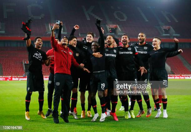 Leverkusen's players celebrate their team's 4:0 win after the German first division Bundesliga football match between FC Cologne and Bayer...
