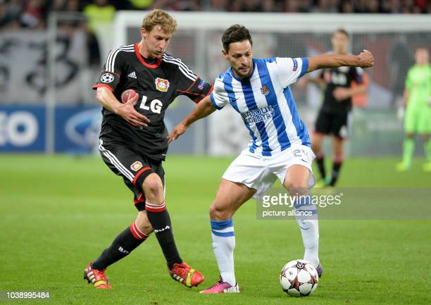 Leverkusen's Stefan Kiessling vies for the ball with San Sebastian's Alberto de la Bella during the Champions League Group A match between Bayer...