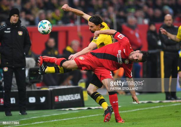 Leverkusen´s striker Kevin Volland and Dortmund's defender Neven Subotic vie for the ball during the German First division Bundesliga football match...
