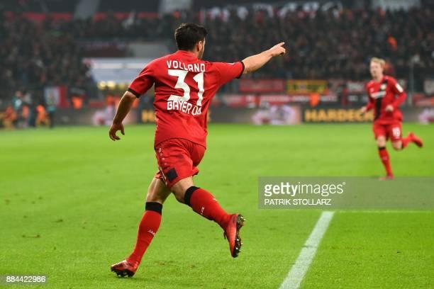 Leverkusen's striker Kevin Volland celebrates after scoring during the German First division Bundesliga football match Bayer Leverkusen vs Borussia...