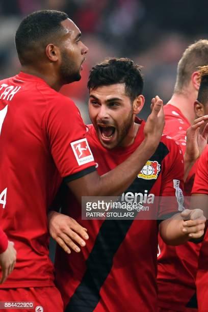 Leverkusen's striker Kevin Volland celebrates with teammates after scoring during the German First division Bundesliga football match Bayer...