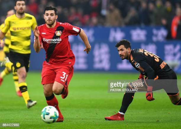 Leverkusen's striker Kevin Volland runs with the ball to score during the German First division Bundesliga football match Bayer Leverkusen vs...
